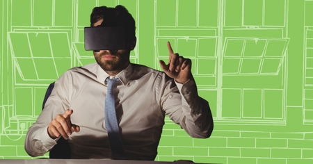 side viewing: Digital composite of Business man at desk in virtual reality headset against white and green hand drawn windows Stock Photo