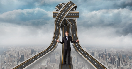 Digital composite of Digital composite image of confused businessman standing on 3d jumbled highway