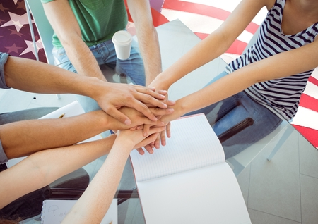 Digital composite of Friends with hands together against american flag
