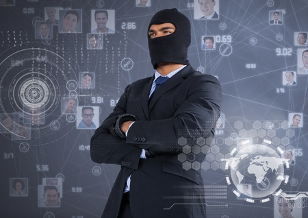 stealer: Digital composite of Businessman with hood and arms crossed in front of digital background Stock Photo