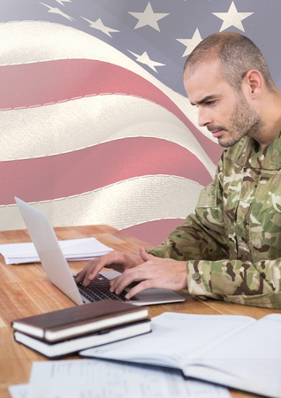 floorboards: Digital composite of Soldier using a laptop in front of american flag