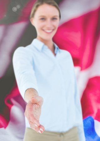 cross legged: Digital composite of Business woman shaking her hand against flag