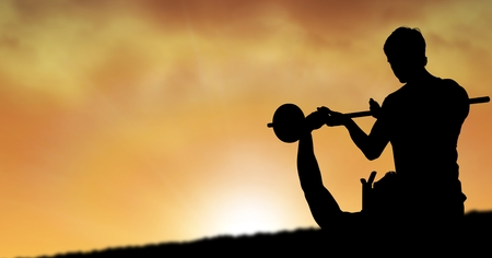 meditation man: Digital composite of Silhouette of instructor assisting man in lifting barbells during sunset Stock Photo