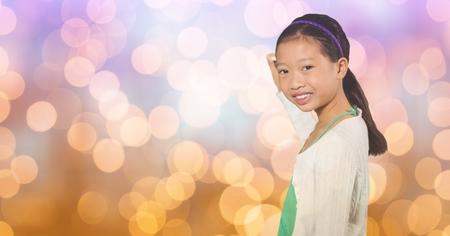 spolužák: Digital composite of Smiling girl writing on blurred background