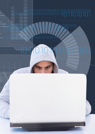 Digital composite of Close up of hacker using a laptop Stock Photo