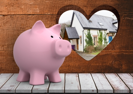 Digital composite of 3D pink piggy bank in front of wood with heart hole where we can see a house blue door(blurred)