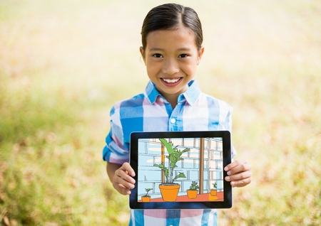 Digital composite of boy showing the house with tablet
