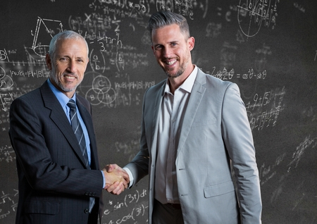 Digital composite of Business men shaking hands against grey wall with math doodles