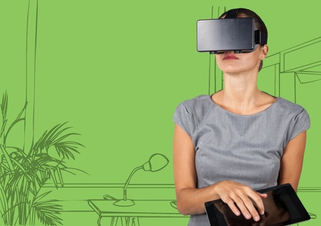 Digital composite of Business woman in virtual reality headset with tablet against 3D green hand drawn office Banco de Imagens