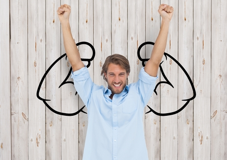Digital composite of happy young businessman hands up in front of fists draw on wood wall