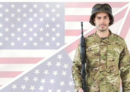 Digital composite of Military holding a weapon against american flag