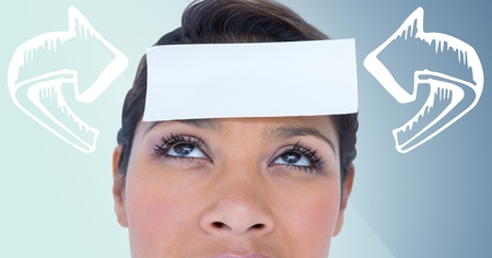 Digital composite of Woman with 3D white curved arrows pointing to card on head against blue background Stock Photo