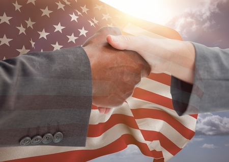 Digital composite of people shaking their hands against american flag