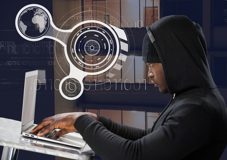 stealer: Digital composite of Side view of hacker using a laptop on a table in front of 3D digital background