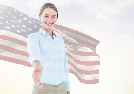 Digital composite of Business woman shaking her hand against american flag Stock Photo