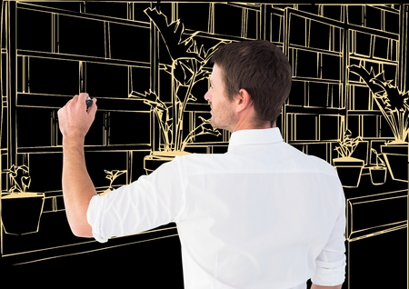 Digital composite of man drawing 3D office light lines in dark background Stock Photo