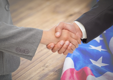 Digital composite of Business people shaking their hands against american flag Stock Photo - 81000201
