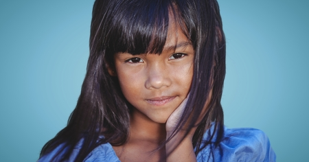 grasslands: Digital composite of Close up of girl against blue background