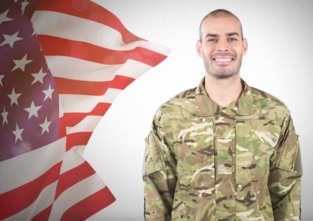 coworker: Digital composite of Smiling soldier near fluttering american flag