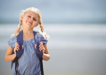 no shirt: Digital composite of Schoolgirl against blurry beach Stock Photo