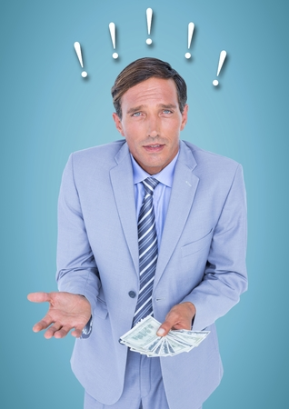 Digital composite of Frustrated business man with money against blue background and exclamation points