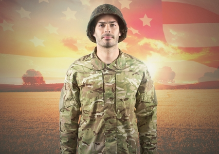 Digital composite of Smiling soldier standing on american flag background