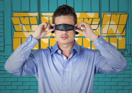 Digital composite of Business man in virtual reality headset against yellow and blue hand drawn windows Stock Photo