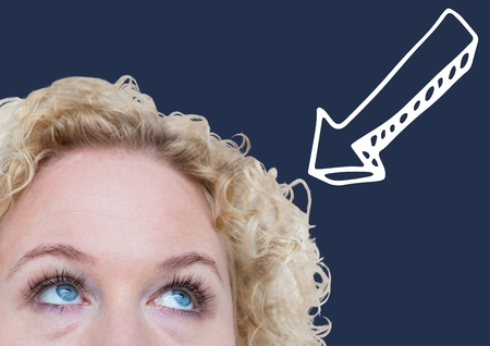 Digital composite of Top of womans head looking at white downward arrow against navy background Stock Photo