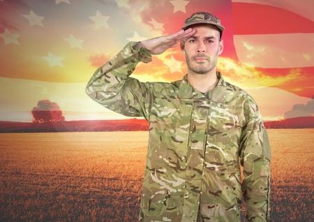 Digital composite of Military saluting against landscape sunset