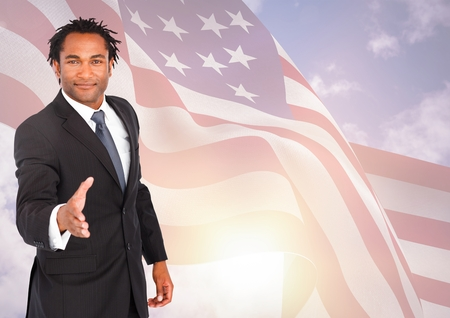 white coat: Digital composite of Business man shaking his hand against american flag