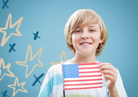 Digital composite of Boy holding american flag against blue background with hand drawn star pattern