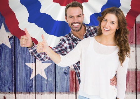 Digital composite of Couple thumbs up for independence day