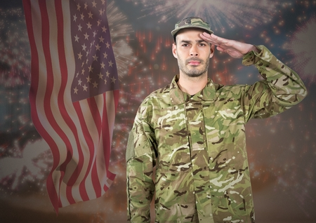 sergeant: Digital composite of Proud soldier saluting against fluttering american flag and fireworks in background