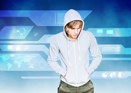 Digital composite of Hacker with a grey sweatshirt in front of blue digital background Stock Photo