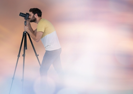photographing: Digital composite of Photographer in front of lights in fog Stock Photo