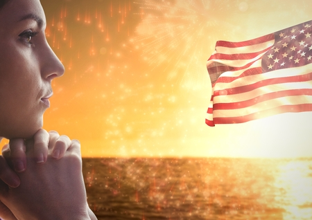 lutheran: Digital composite of Woman thinking against sea and american flag