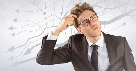 indicate: Digital composite of Frustrated business man against white wall and graph
