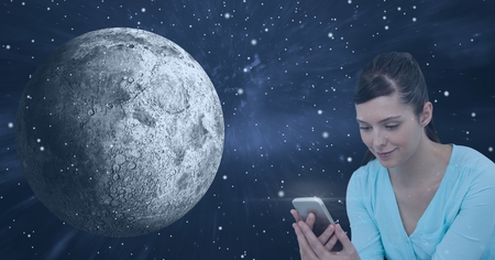 dimensional: Digital composite of Smiling woman texting against universe background