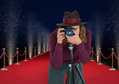 Digital composite of photographer with hat taking a photo with tripod  in the red carpet . Lights behimd Stock Photo