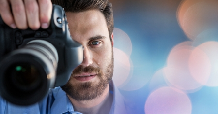 humility: Digital composite of Close-up of photographer taking picture