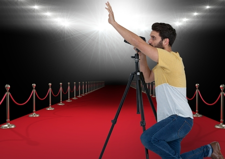 way out: Digital composite of photographer taking a photo in the red carpet with stadium lights on back