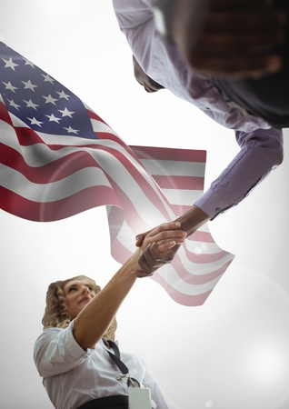 technology transaction: Digital composite of people shaking their hands against american flag