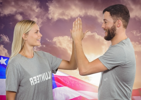 co: Digital composite of Couple high fiving against american flag
