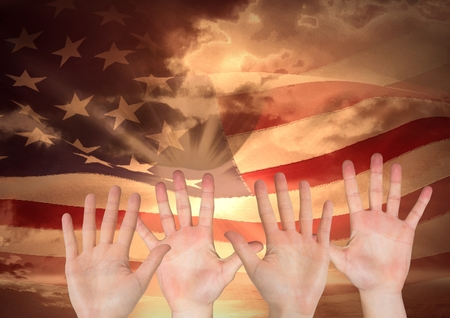 american field service: Digital composite of hands against american flag