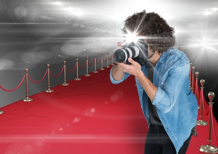 Digital composite of photographer taking a photo with flash in the red carpet. Flares everywhere