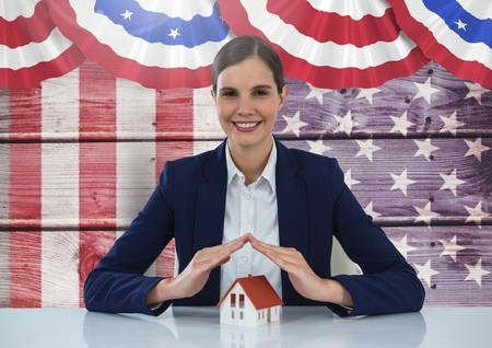 digital composite: Digital composite of Business woman covering a house against american flag Stock Photo