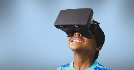 Digital composite of Boy wearing a virtual reality headset