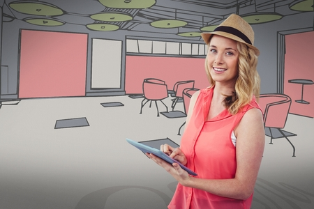 well dressed woman: Digital composite of Smiling blond woman using a digital tablet with a colored drawing on background