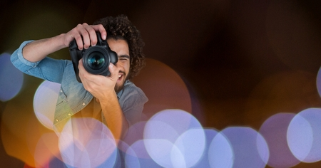 pretending: Digital composite of Photographer taking pictures against glowing background