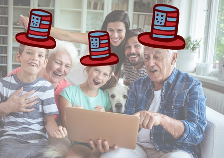 two generation family: Digital composite of Composite image of a family watching at the digital tablet with 4th of july hats Stock Photo